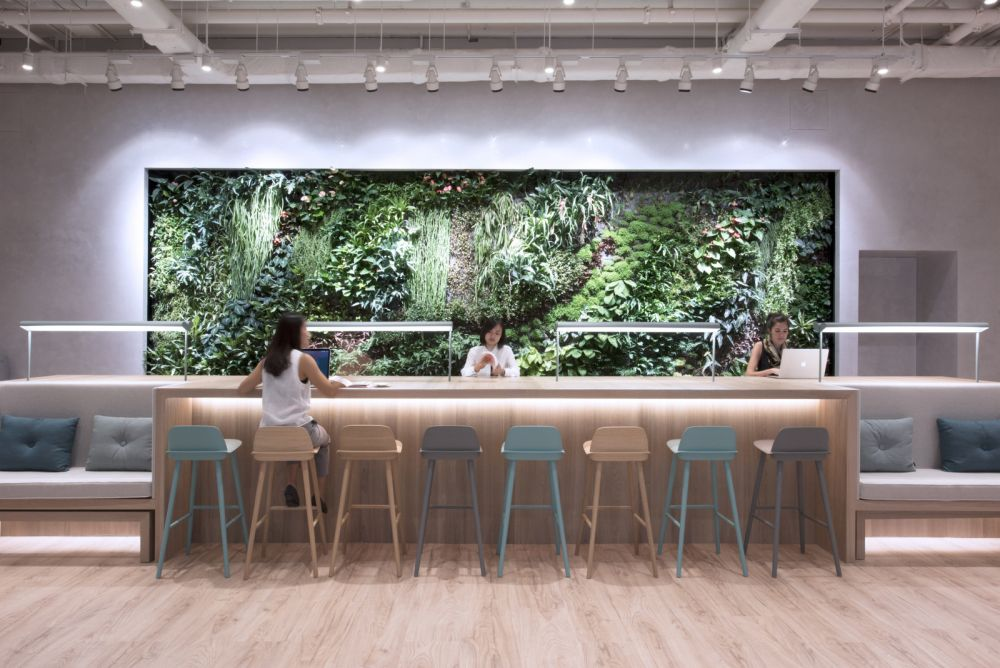 Breakout area with green wall inside coworking office Hong Kong