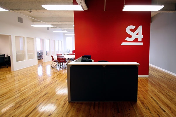 office reception area with red feature wall