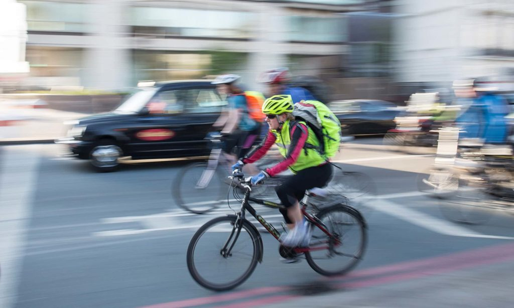 Cyclists riding on London's superhighway